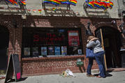 A couple embraces outside the Stonewall Inn in New York on June 12, 2016. An L.G.B.T. ministry plans to hold a Mass on June 27 outside the bar considered the birthplace of the L.G.B.T. civil rights movement. (AP Photo/Mary Altaffer, File)