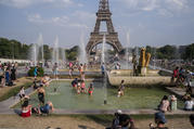 People enjoy the sun and the fountains of the Trocadero gardens in Paris, on Thursday July 25, 2019, when a new all-time high temperature of 42.6 degrees Celsius (108.7 F) hit the French capital. (AP Photo/Rafael Yaghobzadeh)