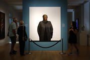 Visitors view a portrait of Nobel laureate Toni Morrison, painted by the artist Robert McCurdy, Tuesday, Aug. 6, 2019, at the National Portrait Gallery in Washington. Morrison, a pioneer and reigning giant of modern literature, died Monday at age 88.