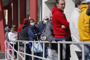 People wait in line for help with unemployment benefits at the One-Stop Career Center on March 17 in Las Vegas. (AP Photo/John Locher)