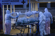 A patient in a biocontainment unit is carried on a stretcher at the Columbus Covid 2 Hospital in Rome, Monday, March 16, 2020. (AP Photo/Alessandra Tarantino)