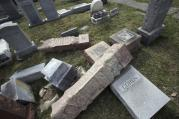 In this Monday, Feb. 27, 2017 file photo,toppled and damaged headstones rest on the ground at Mount Carmel Cemetery in Philadelphia. (AP Photo/Jacqueline Larma)