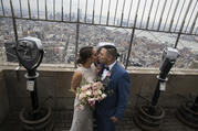 Newlyweds are seen on top the Empire State Building in New York City, 2015 (CNS photo/John Taggart, EPA).