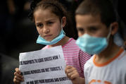 Refugee children join a protest outside the U.N. High Commissioner for Refugees office in Athens, Greece, May 29, 2020. They were protesting a government decision that they should leave their housing provided by European Union and UNHCR funds. (CNS photo/Alkis Konstantinidis, Reuters)