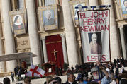 A man holds a banner showing new St. John Henry Newman before the canonization Mass for five new saints celebrated by Pope Francis in St. Peter's Square at the Vatican Oct. 13, 2019. (CNS photo/Paul Haring)