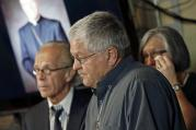 Ron Vasek, center, addresses a news conference along with his wife Patty, right, and attorney Jeff Anderson, left, on May 9, 2017 in St. Paul, Minn. Anderson announced a lawsuit against Bishop Michael Hoeppner of Crookston, Minn., accusing the bishop and diocese of concealing a report of abuse and threatening retaliation against Vasek if he went public. (AP Photo/Jim Mone)