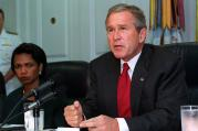 President George W. Bush addresses the media at the Pentagon on Sept. 17, 2001, following a meeting with his national security team and leaders of the National Guard and Reserve forces. Seated at the left is National Security Advisor Condoleezza Rice.