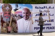 A billboard with a picture of Egyptian Coptic Pope Tawadros II, left, welcomes Pope Francis, at St. Mark's Cathedral in Cairo, Egypt, on Thursday, April 27, 2017.  (AP Photo/Amr Nabil)