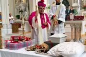 Auxiliary Bishop Jorge H. Rodriguez-Novelo blesses the remains of Julia Greeley in the Cathedral Basilica of the Immaculate Conception in Denver on Wednesday, June 7, 2017. (AP Photo/Colleen Slevin)