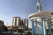 """Mother Mary"" gazes serenely down on the traffic fuming and stalling around her in Ankawa, a suburb of Erbil. (Kevin Clarke)"