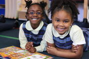 Lala Bonner and River Parks are all smiles at Chicago's St. Ethelreda Catholic School. St. Ethelreda's is among 30 schools that will benefit from a new financial partnership between the Big Shoulders Fund and the Archdiocese of Chicago. Photo courtesy of the Big Shoulders Fund.