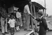 Sen. Robert F. Kennedy meets a resident of Greenville, Miss., in April 1967. (AP Photo/Jack Thornell)