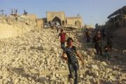 n this Thursday, July 24, 2014 file photo, people walk on the rubble of the destroyed Mosque of The Prophet Younis, or Jonah, in Mosul, 225 miles (360 kilometers) northwest of Baghdad, Iraq.(AP Photo, File)