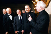 Father O'Hare holds forth with (right to left) Cardinal Avery Dulles and New York Mayors Michael Bloomberg and Ed Koch. Photo courtesy of Fordham University