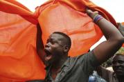 A supporter of opposition leader Raila Odinga celebrates after hearing the decision of Kenya's Supreme Court on Sept. 1 to nullify President Uhuru Kenyatta's election win last month. (AP Photo/Brian Inganga)