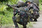 Government troops take positions as fighting with Muslim militants in Marawi city enters its second week on Tuesday, May 30, 2017, in southern Philippines. (AP Photo/Bullit Marquez)
