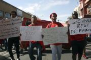 At a May Day rally in Bloemfontein, South Africa, trade unionists demand that South African President Jacob Zuma step down. The president was jeered by labor activists and his speech was cancelled after scuffles broke out between his supporters and workers chanting for him to step down at the rally. (AP Photo/Khothatso Mokone)