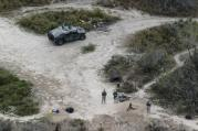 In this Feb. 24, 2015, file photo, members of the National Guard patrol along the Rio Grande at the Texas-Mexico border in Rio Grande City, Texas. (AP Photo/Eric Gay, File)