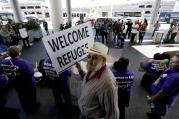 Demonstrators outside Tom Bradley International Terminal during a protest by airport service workers from United Service Workers West union on Jan. 30, 2017, at Los Angeles International Airport. The vigil is in support of travelers affected by the executive order restricting travel from seven primarily Muslim countries. (AP Photo/Chris Carlson)