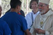 Bishop Gerald Kicanas of the Diocese of Tucson celebrated Mass at the Florence Detention Facilty on October 20, 2014. Sr. Lynn Allvin, the Chaplain at Florence Federal Detention Center, is behind him in this picture (DHS).