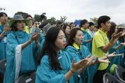 Young people pray as Pope Francis celebrates the closing Mass of the sixth Asian Youth Day at Haemi Castle in Haemi, South Korea, Aug. 17 (CNS photo/Paul Haring) .