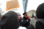 A police officer warns demonstrators who support legal abortion that they would be arrested if they continued to block the path of pro-life advocates during the March for Life in Washington, Jan. 22 (CNS photo/Gregory A. Shemitz).