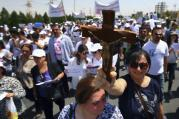 Hundreds of Iraqi Christians marched to the United Nations office in Irbil on July 24, calling for help for families who fled in the face of threats by Islamic State militants.