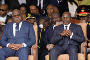 Congolese President Felix Tshisekedi, left, and outgoing president Joseph Kabila sit side by side during the inauguration ceremony in Kinshasa, Democratic Republic of the Congo on Jan. 24, 2019. (AP Photo/Jerome Delay)