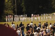 "THE GUILTY REMNANT. A mysterious cult protests a parade honoring the departed in the first episode of ""The Leftovers."""