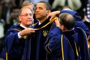 The chairman of the University of Notre Dame's board of trustees, Richard C. Notebart, and university registrar Harold L. Pace present U.S. President Barack Obama with an academic stole signifying the honorary degree he received during the commencement c eremony at the university in Notre Dame, Ind., in late May. (CNS photo/Christopher Smith)