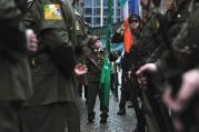INNOCENCE AND EXPERIENCE. Brian Kiernan, 11, attends a Sinn Fein rally with members of the Finglas 1916 Commemoration group in Dublin on Jan. 31.