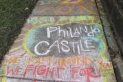A chalk tribute to Philando Castile marks a sidewalk across the street from the governor's residence as demonstrators gather outside the governor's residence Friday, July 8, 2016, in St. Paul, Minn., where protests continue over the shooting death by police of Castile after a traffic stop Wednesday, July 6, in Falcon Heights. (AP Photo/Jim Mone)