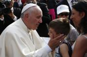 Pope Francis greets a boy during a gathering with young people in Turin, Italy, June 21 (CNS photo/Paul Haring).