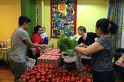 The weekly food basket distribution at Romero House