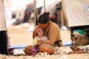 SAFE AT LAST. A woman who fled the violence in the Iraqi town of Sinjar at a camp in Syria's northern town of Qamishli.