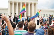 COURT'S CALLS. Supporters of same-sex marriage celebrate in front of the Supreme Court on June 26.