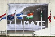 CLIMATE CHECK. A banner waving from the U.N. General Assembly building in New York on June 30 defines the nature of the debate inside.