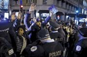 HANDS UP. Demonstrators confront police officers during a protest in reaction to the fatal shooting of Laquan McDonald in Chicago, Ill., on Nov. 27, 2015.