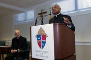 The archbishop designated by Pope Francis to the Archdiocese of Washington, Archbishop Wilton D. Gregory, speaks during a news conference as Cardinal Donald Wuerl looks on, at Washington Archdiocesan Pastoral Center in Hyattsville, Maryland, on April 4, 2019. (AP Photo/Jose Luis Magana)