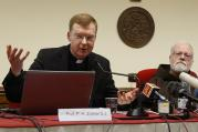 Jesuit Father Hans Zollner, president of the Center for Child Protection at the Pontifical Gregorian University in Rome, speaks at a news conference officially launching the center Feb. 16, 2015 (CNS photo/Paul Haring).