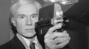 Artist and underground filmmaker Andy Warhol poses with one of Polaroid's new film cameras, the Polavision camera, which features instant replay on television screens, Feb. 1, 1978. (AP Photo/Dave Pickoff)