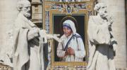 A tapestry of St. Teresa of Kolkata is seen on the facade of St. Peter's Basilica as Pope Francis celebrates her canonization Mass at the Vatican Sept. 4. (CNS photo/Paul Haring)