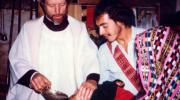 Father Stanley Rother, a priest of the Oklahoma City Archdiocese who was brutally murdered in 1981 in the Guatemalan village where he ministered to the poor, is shown baptizing a child in this undated photo. The Archdiocese of Oklahoma City announced the North American priest will be beatified on Sept. 23 in Oklahoma. (CNS)