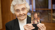 Sister Marita Rother, a member of the Adorers of the Blood of Christ, holds a picture of her brother, Father Stanley Rother, a priest of the Oklahoma City Archdiocese, who will be beatified on Sept. 23 in Oklahoma City. (CNS photo/Christopher Riggs, Catholic Advance)