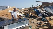 Lin Barton surveys the damage at the marina in Rockport where he has lived and worked. (Photos by Jan-Albert Hootsen)