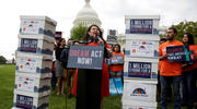 Rosa Martinez, an immigration activist and a recipient of the Deferred Action for Childhood Arrivals program, takes part in a rally Sept. 12 in Washington urging Congress to pass the DREAM Act. (CNS photo/Joshua Roberts, Reuters)