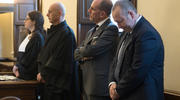 Giuseppe Profiti, second from right, former president of Bambino Gesu hospital in Rome, and Massimo Spina, right, former treasurer of the hospital, are pictured during their sentencing at the Vatican court Oct. 14. Profiti was found guilty of illicit appropriation and use of funds belonging to the Bambino Gesu Foundation. He was given a suspended sentence of one year in jail and a 5,000 Euro fine. Spina was absolved of the charges. (CNS photo/L'Osservatore Romano)