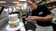 Baker Jack Phillips decorates a cake in his Masterpiece Cakeshop Sept. 21 in Lakewood, Colo. The Supreme Court was set to hear oral arguments Dec. 5 in the case of the baker who cited religious freedom in his refusal to design a wedding cake for a same-sex couple. (CNS photo/Rick Wilking, Reuters)