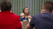 Tanelle Pearson is seen with her 7-month-old son during a breakout session on May 16 at the National Young Adult Ministry Summit at the St. John Paul II National Shrine in Washington. (CNS photo/Tyler Orsburn)