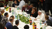 Pope Francis eats lunch with poor people